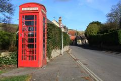 traditional  iconic red british phone box in rural village