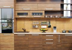 Modern wooden kitchen with oven