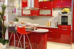 Home interior with new modern red kitchen