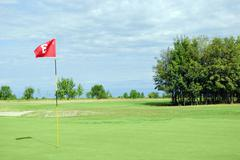 Golf course with red flag number three