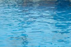 a clear blue pool water abstract background