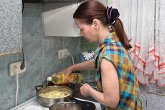 the woman fries cabbage on sunflower oil