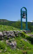 a mountain landscape with cast iron bell.