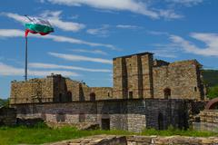 a view on bulgarian castle in veliko tarnovo with national flag.