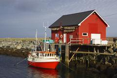 norwegian fishing boat with fishing house on island of vaeroy, lofoten