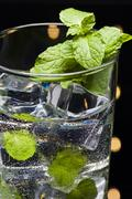 .green mojito cocktail with fresh mint leaves