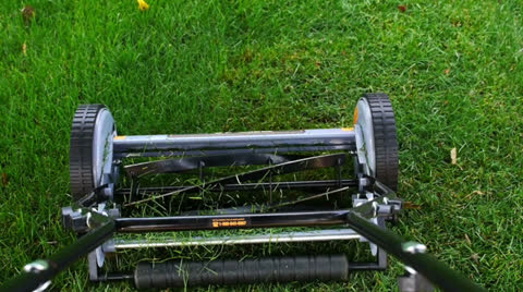3136 Looking down at a manual lawn mower.