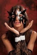image of a girl wearing black star mask