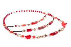red gem necklace on white