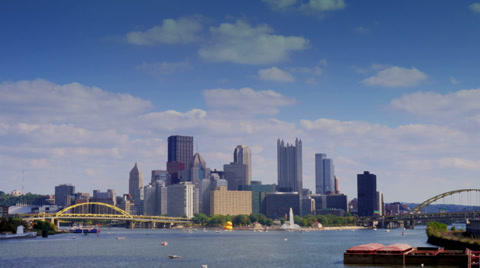 3602 A time lapse shot of the Pittsburgh city skyline as seen from the West End Bridge on a early Fall afternoon.  Plenty of copy space for your text or graphics. Corporate logos digitally removed for general stock footage use.  Available in Ultra-HD 4K.