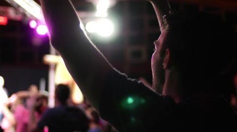 praise and worship in a modern contemporary church service, raised arms