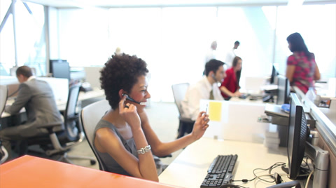 Customer services call centre team on telephones. High quality HD video footage