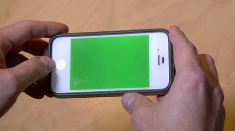 3947 Depositing a check with a mobile phone. Green screen phone with luma matte for your custom screen content.
