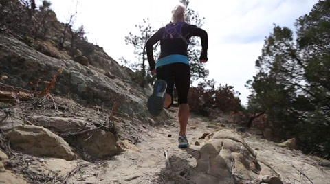 Women running up rocky trail colorado