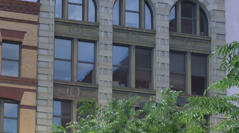 4442 Zooming into a typical New York style apartment or office building establishing shot.