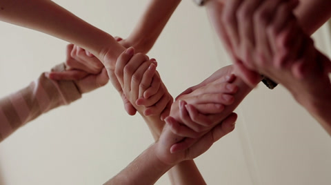 Many hands are connected greeting