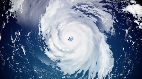 4482 A fictional hurricane resembling Katrina spins in the open ocean.  Modified hurricane image courtesy of NOAA.GOV.