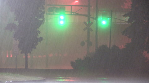 Torrential heavy flooding rain thunder and lightning in severe storm at night.