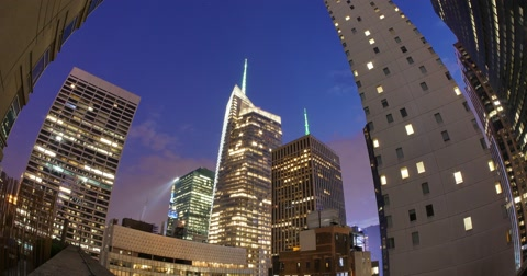 4684 A time lapse day to night view of the Bank of America Tower in New York City.