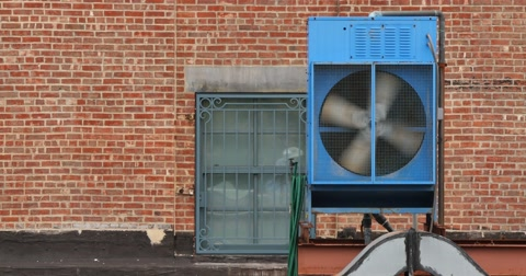 4754 An air conditioning unit spins on a rooftop in New York City.