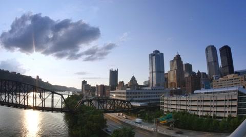 4909 A timelapse establishing shot of the skyline of Pittsburgh at dusk.