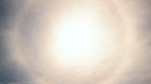 Time lapse footage of rare halo phenomena caught on camera with perfect circular rainbow around the sun