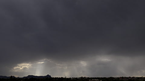 Time Lapse, Rain shafts, sun rays break through sky blackout storm clouds. 4K UHD 3840x2160
