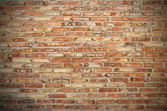 rough brick wall background texture with vignette