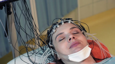 Woman in sleep having brain scan in hospital HD