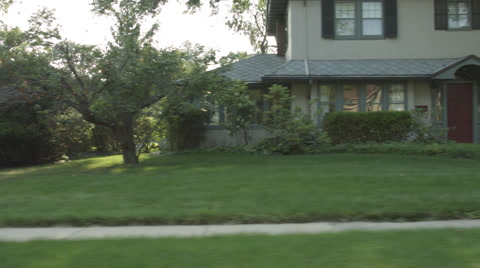 Driving plate: right side (driver) view, upper middle class 1930s and 40s-era homes in an affluent Mid West US neighborhood.  Intended for compositing.  24mm lens, stabilized clip, recorded in 4K, UHD.