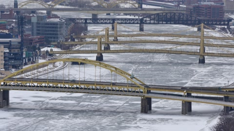 5590 A winter establishing shot of the Fort Duquesne Bridge and the Three Sisters Bridges on Pittsburgh's north side.
