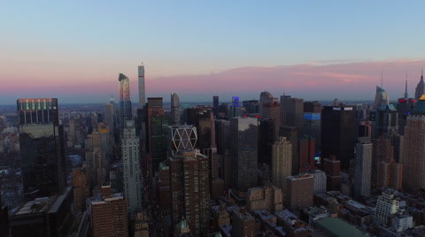 v11 Flying into city and over West 57th St towards Midtown Manhattan area after sunset. 3/11/15