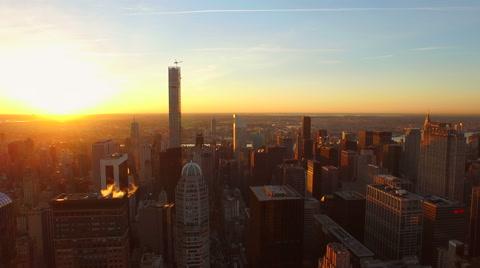 v86 Flying low over Midtown Manhattan buildings towards beautiful sunrise. 3/13/15