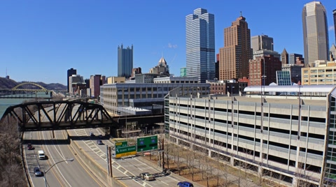 5656 An establishing shot of the Pittsburgh city skyline during the day in early Spring.