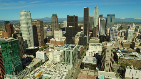 v93 Aerial backwards and over downtown with cityscape view.