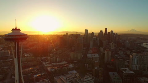 v51 Flying low over Lower Queen Anne area and downtown at sunrise with beautiful views.