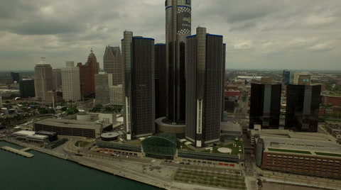 v30 Flying low over Detroit River panning left with cityscape views.