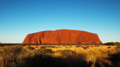 a time lapse of uluru/ayers rock in australia's northern territory at sunset
