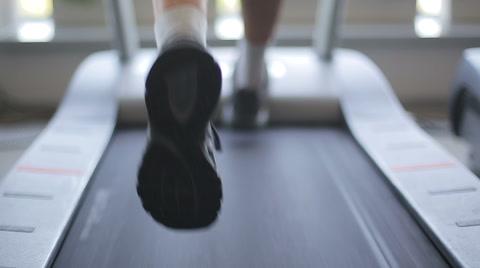 Man running on a treadmill. Close up shot