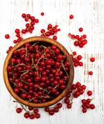 fresh red currant on a old wooden table