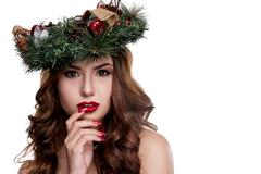 Christmas or New Year beauty girl portrait isolated on white background. Beautiful woman with luxury makeup and christmas wreath on head. Christmas mood