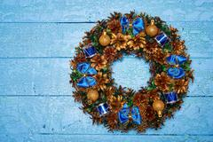 Christmas wreath on blue painted wooden background