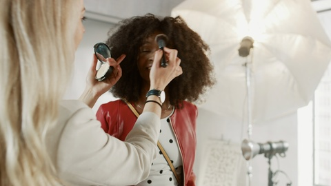 Backstage of the Photo Shoot: Make-up Artist Applies Makeup on a Young Beautiful Black Model, in a Moment Photographer Starts Taking Photos with Professional Camera. Fashion Magazine Cover Photoshoot. Shot on 8K RED Camera.