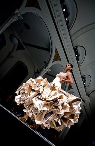 14__vibiana_runway_model_white_newspaper_dress_-_copy.slide