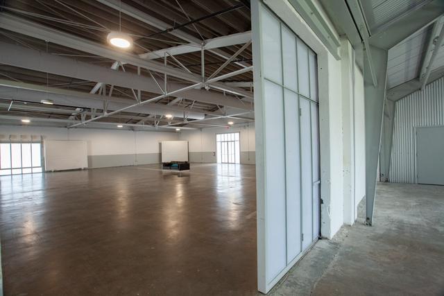 Sliding_door_separating_hanger_and_main_warehouse.slide