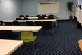 Classroom_with_rows_of_tables.search_thumb