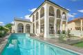 White-concrete-building-near-swimming-pool-3797503.search_thumb