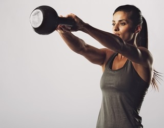 attractive female doing kettlebell swing