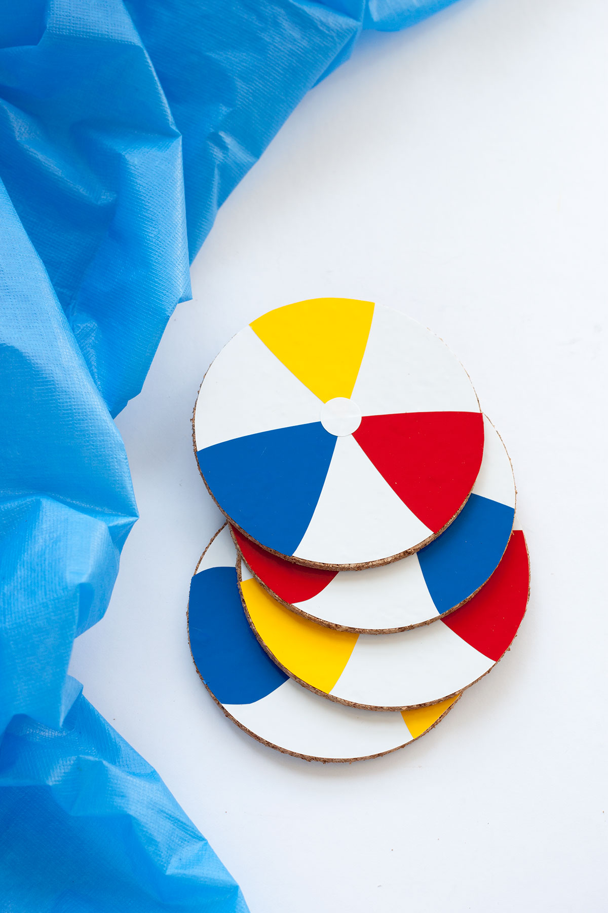 DIY Beach Ball Coasters- Paint the Gown Red