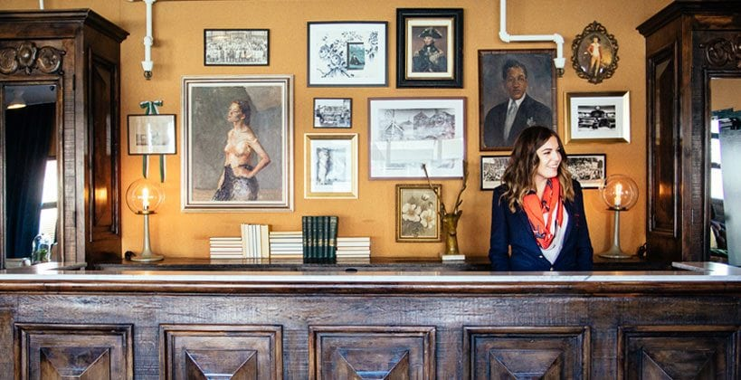 Front desk of Palihotel Melrose Avenue, with a helpful clerk standing by